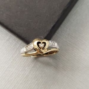 Silver and gold heart ring.
